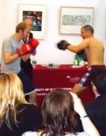 Keevil V Johnston: authors in charity boxing match at the Cheltenham Literature Festival, 2013, refereed by Martin Randall.